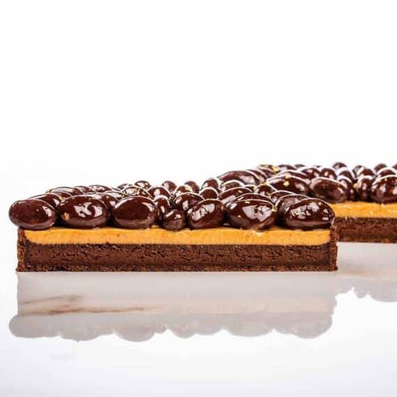 Fave di cacao ricoperte di cioccolato fondente